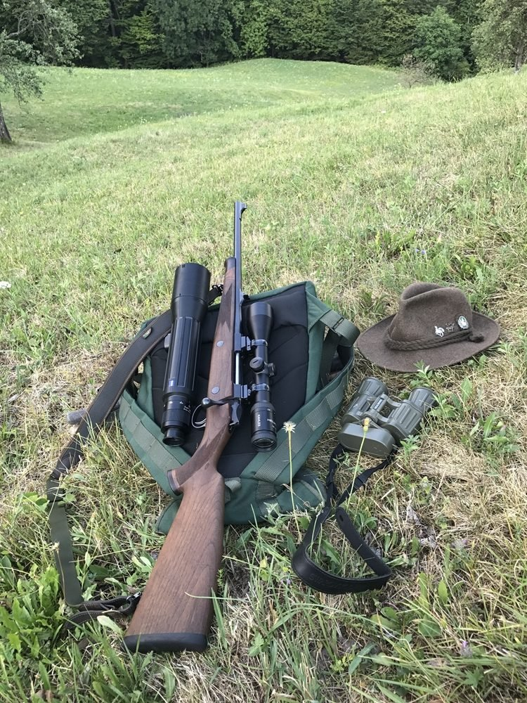 A rifle with optics -  hunting riflescope