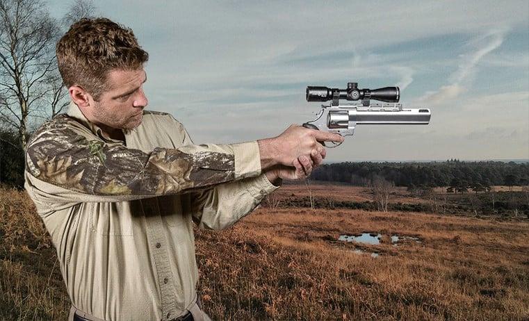 A handgun scope mounted on a revolver - black matte optics